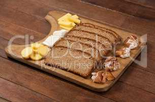 Slices of brown bread and variety of cheese