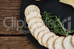 Nacho chips and rosemary herbs on plate