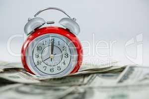 Alarm clock with dollars