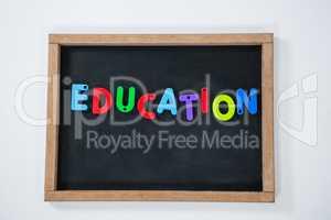 Letter education block on slate