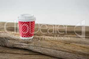Disposable coffee cup with polka dots