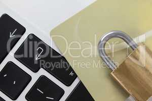 Metallic lock with smart card on laptop