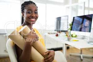 Woman sitting on a chair and holding chart holder