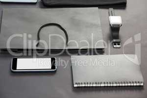 Smartphone, diary, shopping bag and watch