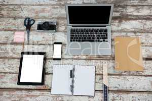 Laptop, digital tablet, smartphone and camera with office accessories