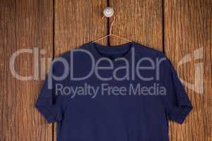 Navy blue t-shirt on hanger