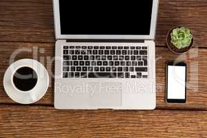 Laptop and smartphone with cup of coffee