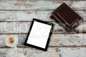 Digital tablet, diary and cup of coffee