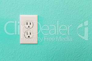 Electrical Sockets In Colorful Bright Teal Wall