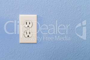 Electrical Sockets In Colorful Blue Wall