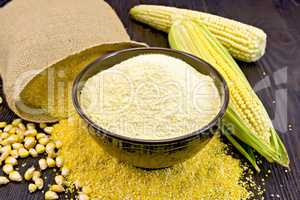 Flour corn in bowl with bag on board