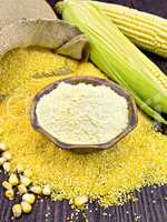 Flour corn in bowl with grits on dark board