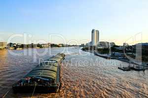 Floating ships on the Chao Phraya River in Bangkok. Thailand
