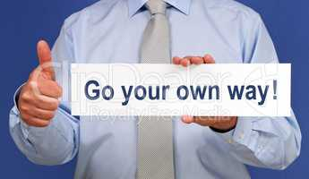 Go your own way - Businessman with thumb up
