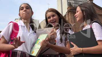 Teen Female Students With Textbooks