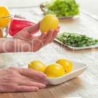 Female hands inspecting lemons