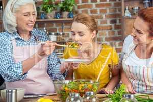 Woman tasting vegetable salad