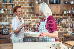 Two women in kitchen