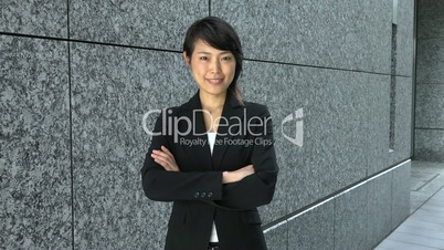 Career And Success For Young Asian Businesswoman Looking At Camera