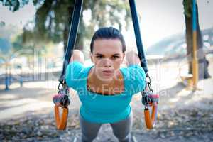 Serious woman training in the park