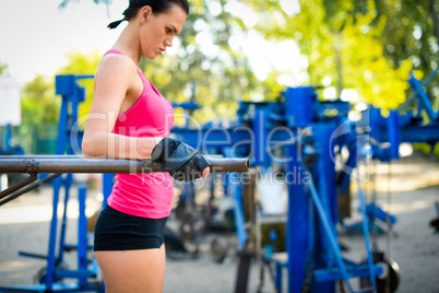 Woman doing exercise on bars