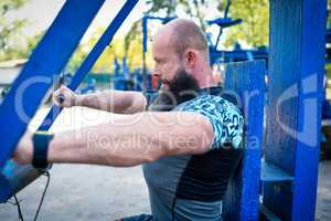 Man training on chest press equipment
