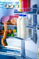Open refrigerator filled with food