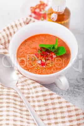 Bowl of fresh tomato soup gazpacho on a napkin