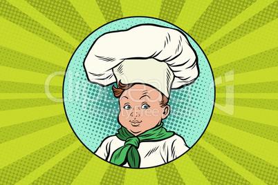 boy in white chefs hat