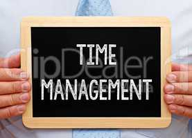 Time Management - Businessman with Chalkboard