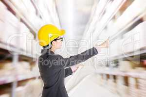 Store manager counting stock in warehouse