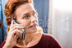 Woman talking on smartphone