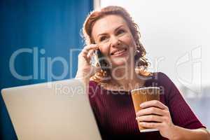 Woman talking on smartphone
