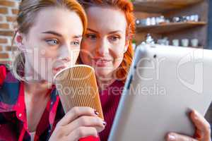 Women using digital tablet