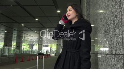 Winter Season Cold Weather With Asian Businesswoman On The Phone