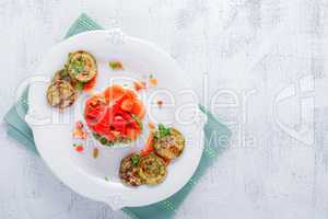 Rice timbale with fried zucchini peppers, carrots.