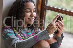 Mixed Race African American Girl Teenager on Cell Phone