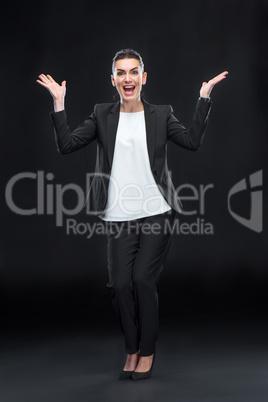 Attractive businesswoman gesturing