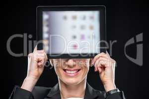 Businesswoman showing digital tablet