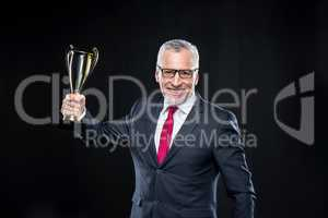 Businessman with award cup