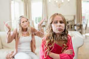 Furious mother arguing with her daughter in living room