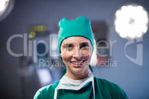 Portrait of female surgeon smiling in a operating room