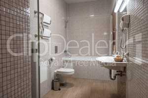 Fine hotel bathroom interior in beige and white
