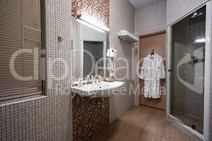 Fine hotel bathroom interior in beige color