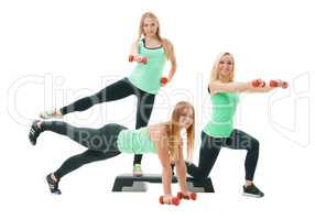 Slim sportswomen in tops and leggings pose in studio