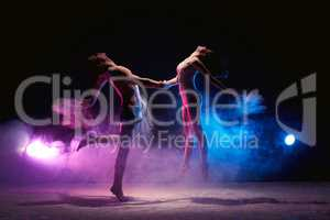 Couple dancing on the scene in cloud of powder