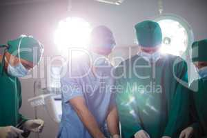 Medical team performing operation in a operating room