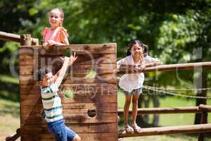 Kids playing on a playground ride in park