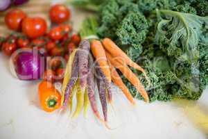 Various vegetables on kitchen worktop