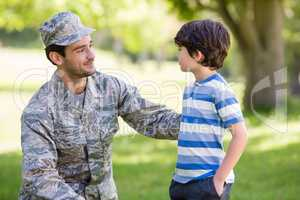 Army soldier interacting with boy